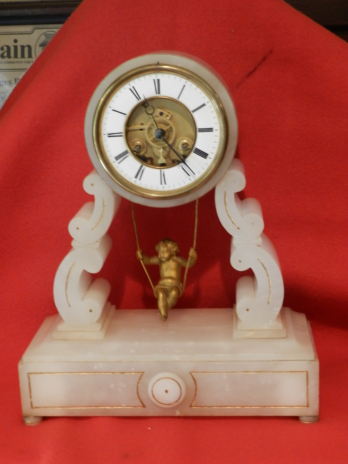 French alabaster clock with swinging cherub : Rideau Clock Repair
